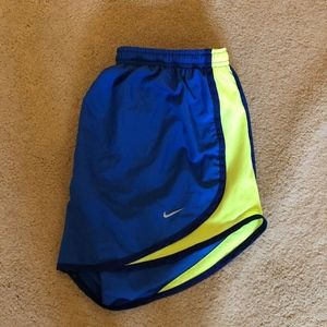Nike blue and yellow running shorts